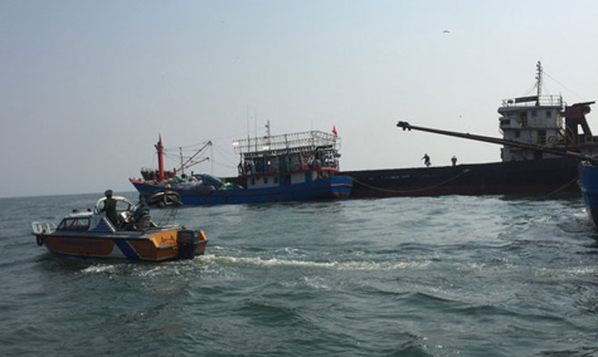 Cargo ship sinking in South China sea, towed to safety